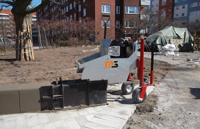Машина для установки бордюрів та тротуарів